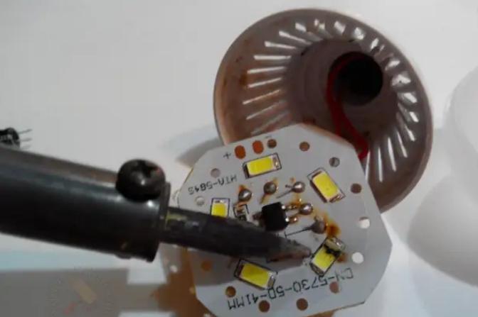 Можно выпаивать сгоревший светодиод, но проще нагреть плату с обратной стороны небольшой горелкой.